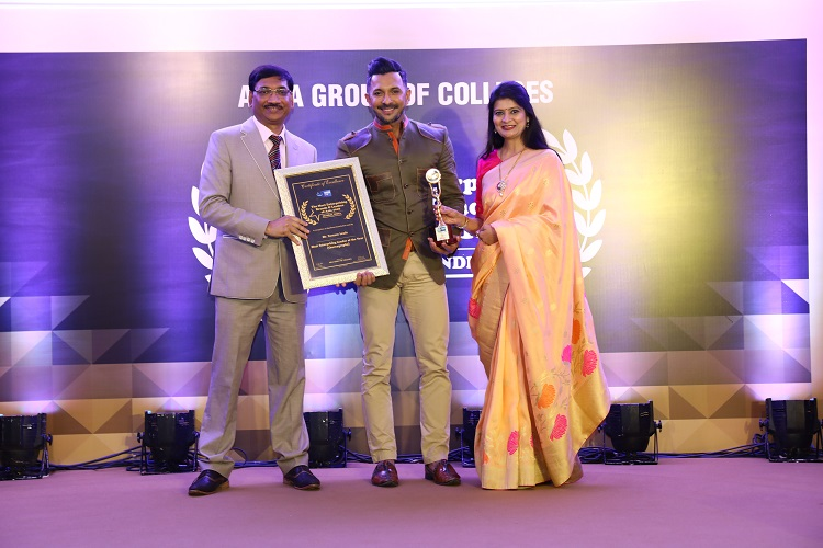 Dr. Arvind Agarwal, MBBS, President, Arya Group of Colleges and Dr. Puja Agarwal, Group Director - Arya Group of Colleges giving award to Celebrity Choreographer Mr. Terence Lewis
