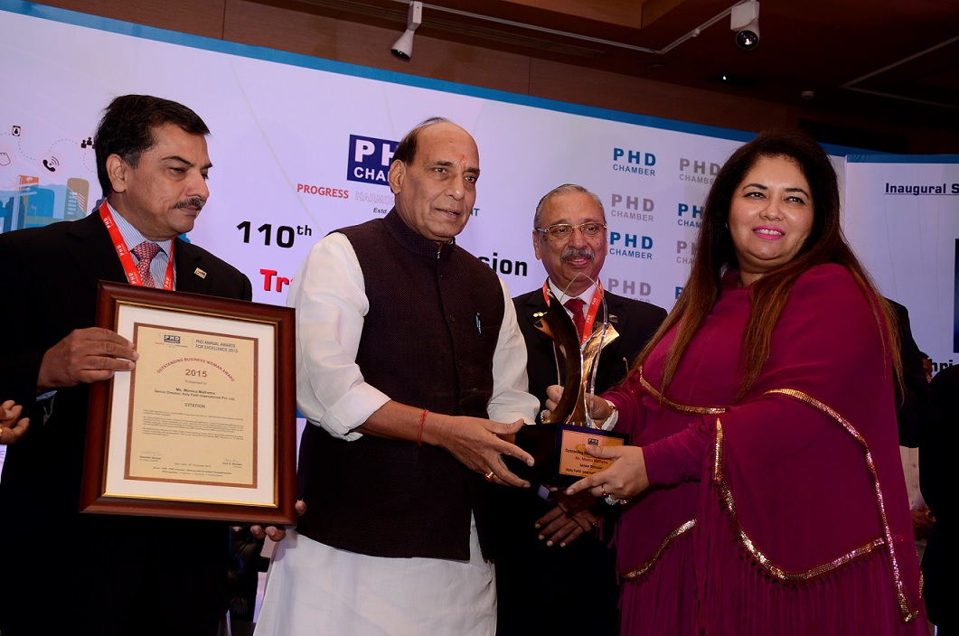 Ms. Monica Malhotra Kandhari receiving PHD Chamber's prestigious Outstanding Business Woman of the Year award from Mr. Rajnath Singh, the Home Minister of India